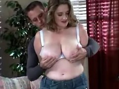Pretty busty lady does fine blowjob
