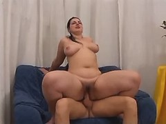 Portly busty honey fucking with dude on bed