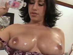 Brunette plumper presents her massive oiled boobs