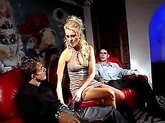 Blond slut blows two dick