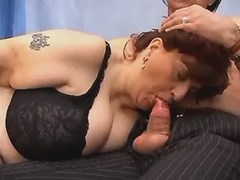 Kinky mature woman sucks hard dick in studio