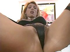 Sexy blond shemale in stockings gets anal pleasure