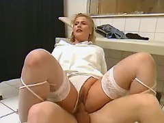 Plump nurse doing patient