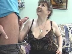 Lonely chesty grandma seduces repairman on sofa