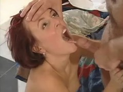 Skillful redhead girl catches facial after blowjob